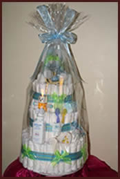 Wrapping on 3 layer blue nappy cake for boys