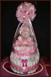 Wrapping on pink diaper cake